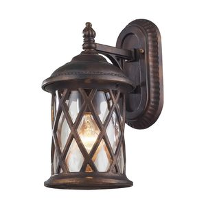 1 Light Outdoor Sconce In Hazlenut Bronze And Designer Water Glass by Elk Lighting